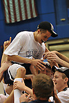 19 MAR 2011: University of St. Thomas (Minnesota) teammates lift tournament MVP Tyler Nicolai into the air in celebration after their victory over the College of Wooster during the Division III Men's Basketball Championship held at the Salem Civic Center in Salem, VA. The University of St. Thomas (Minnesota) defeated College of Wooster 78-54 to win the national title.  Andres Alonso/NCAA Photos