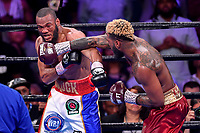 """Fairfax, VA - May 11, 2019: Jarrett """"Swift"""" Hurd connects with a right hand during Jr. Middleweight title fight at Eagle Bank Arena in Fairfax, VA. Julian Williams defeated Hurd to take home the IBF, WBA and IBO Championship belts by unanimous decision. (Photo by Phil Peters/Media Images International)"""