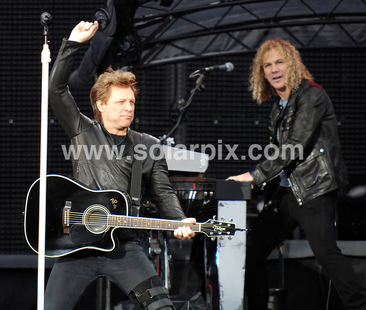 **ALL ROUND PICTURES FROM SOLARPIX.COM**                                             **WORLDWIDE SYNDICATION RIGHTS**                                                                                  Caption: Jon Bon Jovi and his band Bon Jovi play in concert at Old Trafford, Manchester, UK. 24 June 2011                                                                              This pic: Bon Jovi                                                                                              JOB REF: 13643 SGD       DATE: 24_06_2011                                                           **MUST CREDIT SOLARPIX.COM OR DOUBLE FEE WILL BE CHARGED**                                                                      **MUST AGREE FEE BEFORE ONLINE USAGE**                               **CALL US ON: +34 952 811 768 or LOW RATE FROM UK 0844 617 7637**