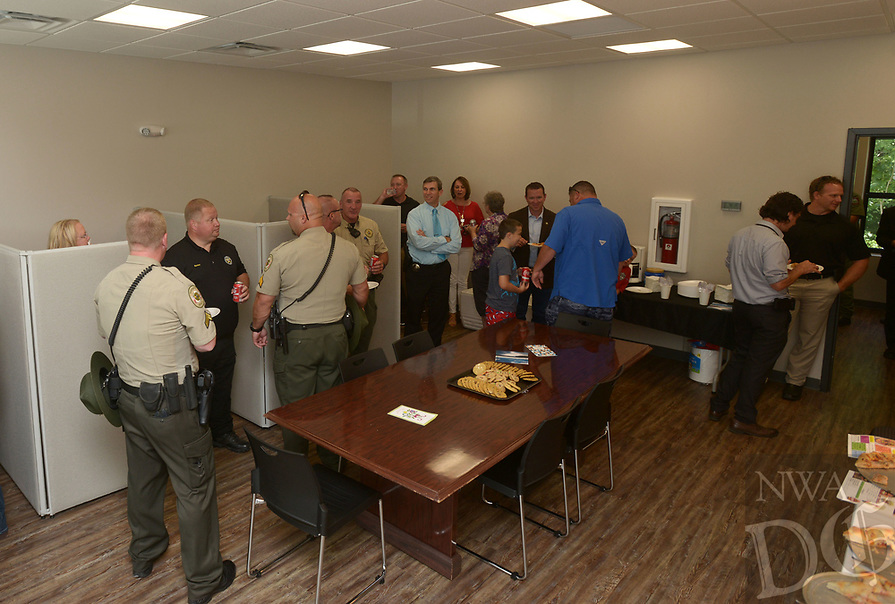 NWA Democrat-Gazette/BEN GOFF @NWABENGOFF<br /> Guests mingle Thursday, June 22, 2017, during a grand opening for the new Benton County Sheriff's Office Prairie Creek substation on Arkansas highway 12 near Beaver Lake. The new 1,500 square foot facility will have space for deputies and Arkansas Game and Fish Commission officers to work and store equipment. The sheriff's office already has substations in Siloam Springs, Gravette and Avoca.