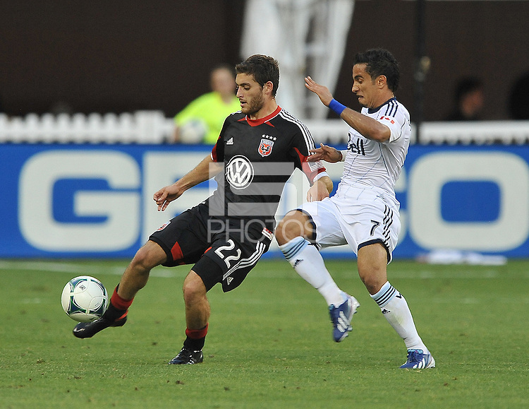 Chris Korb (22) of D.C. United goes against Camilo Sanvezzo (7) of the Vancouver Whitecaps FC. The Vancouver Whitecaps FC defeated D.C. United 1-0, at RFK Stadium, Saturday June 29 , 2013.