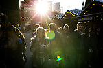 © Joel Goodman - 07973 332324 . 21 November 2013 . Manchester , UK . Low sun bursting through . Candid photos of the Christmas Markets in Manchester City Centre . Photo credit : Joel Goodman