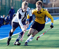 Andrew Cornick (L) of Hampstead outpaces a Loughtonian player during the EHL Mens Cup Quarter-Final game between Hampstead and Westminster and Old Loughtonians at the Paddington Recreation Ground, Maida Vale on Sun Mar 7, 2010