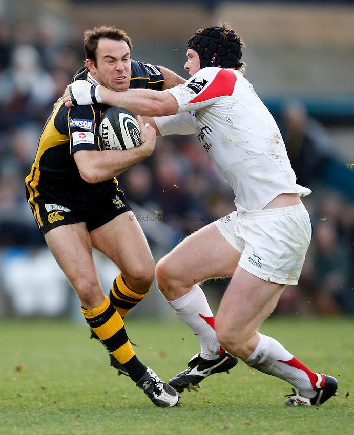Photo: Richard Lane/Richard Lane Photography..London Wasps v Newcastle Falcons. Guinness Premiership. 25/11/2007. .Wasps' Fraser Waters is tackled by Falcons' Ben Woods.