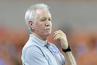 Houston, TX - Saturday June 17, 2017: Tom Sermanni watches his team playing against Houston during a regular season National Women's Soccer League (NWSL) match between the Houston Dash and the Orlando Pride at BBVA Compass Stadium.