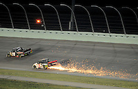 Nov. 14, 2008; Homestead, FL, USA; NASCAR Craftsman Truck Series driver Mike Skinner (5) blows a tire as J.R. Fitzpatrick (71) passes him during the Ford 200 at Homestead Miami Speedway. Mandatory Credit: Mark J. Rebilas-