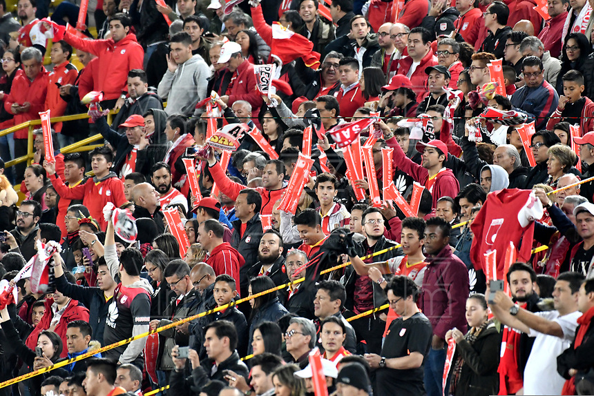 BOGOTÁ-COLOMBIA, 24-03-2019: Hinchas de Independiente Santa Fe, animan a su equipo, durante partido de la fecha 11 entre Independiente Santa Fe y Once Caldas, por la Liga Águila I 2019, en el estadio Nemesio Camacho El Campin de la ciudad de Bogotá. / Fans Independiente Santa Fe, cheer for their team during a match of the 11th date between Independiente Santa Fe and Once Caldas, for the Aguila Leguaje I 2019 at the Nemesio Camacho El Campin Stadium in Bogota city, Photo: VizzorImage / Luis Ramírez / Staff.