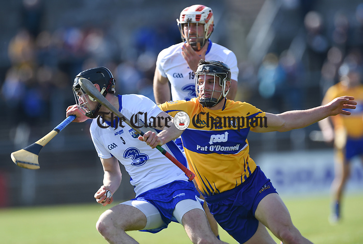 Barry Coughlan of Waterford  in action against John Conlon of Clare during their National League game at Cusack Park. Photograph by John Kelly.
