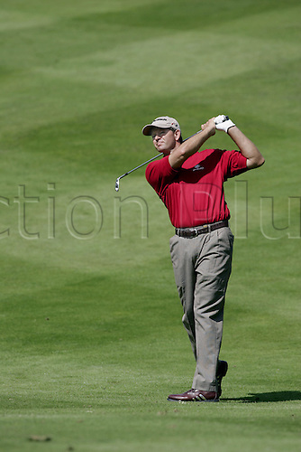 25 May 2006: South African golfer Retief Goosen (RSA) watches his approach shot from the 7th fairway during the first round of the BMW Championship, played on the West Course at Wentworth. Photo: Glyn Kirk/Actionplus...060525 golf man male