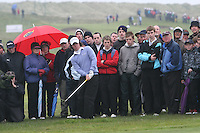 Rory McElroy hits out from the crowd, day 1 of the Irish Open in Co.Louth Golf Club,  Baltray....Photo NEWSFILE/Jenny Matthews.(Photo credit should read Jenny Matthews/NEWSFILE)....This Picture has been sent you under the condtions enclosed by:.Newsfile Ltd..The Studio,.Millmount Abbey,.Drogheda,.Co Meath..Ireland..Tel: +353(0)41-9871240.Fax: +353(0)41-9871260.GSM: +353(0)86-2500958.email: pictures@newsfile.ie.www.newsfile.ie.FTP: 193.120.102.198.