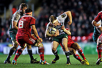 Brendon O'Connor of Leicester Tigers is tackled in possession. European Rugby Champions Cup match, between Leicester Tigers and Munster Rugby on December 20, 2015 at Welford Road in Leicester, England. Photo by: Patrick Khachfe / JMP