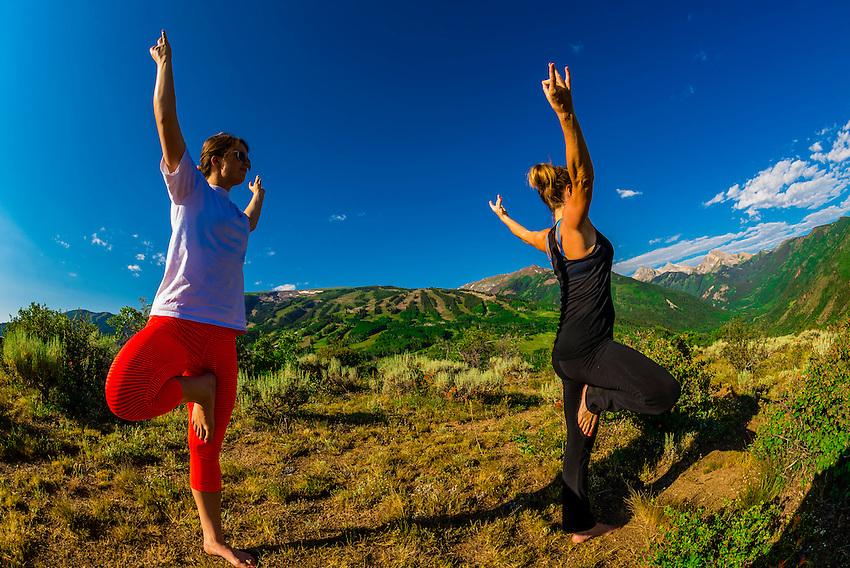 Women doing yoga, Rim Creek Trail, above Snowmass Village (Aspen), Colorado USA.