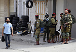 Israeli security forces and Jewish settlers close a street to mark the Sukkot (Feast of Tabernacles) which marks the exodus of the ancient Hebrew people from Egypt, in the West Bank city of Hebron on October 16, 2019.  Samaritans are a community of a few hundred people living in Israel and in the Nablus area, who trace their lineage to the ancient Israelites Moses led out of Egypt . Photo by Mosab Shawer