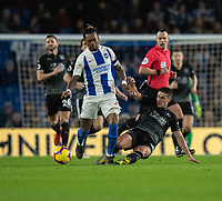 Brighton & Hove Albion's Gaetan Bong (left) is tackled by Burnley's Ashley Westwood (right) <br /> <br /> Photographer David Horton/CameraSport<br /> <br /> The Premier League - Brighton and Hove Albion v Burnley - Saturday 9th February 2019 - The Amex Stadium - Brighton<br /> <br /> World Copyright © 2019 CameraSport. All rights reserved. 43 Linden Ave. Countesthorpe. Leicester. England. LE8 5PG - Tel: +44 (0) 116 277 4147 - admin@camerasport.com - www.camerasport.com