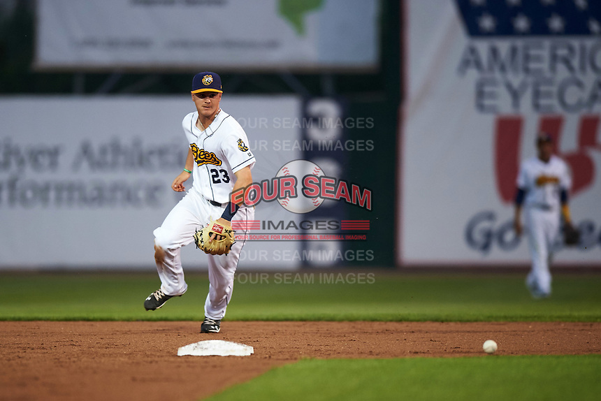 Burlington Bees second baseman Brendon Sanger (23) fields a ground ball up the middle during a game against the Bowling Green Hot Rods on May 7, 2016 at Community Field in Burlington, Iowa.  Bowling Green defeated Burlington 11-1.  (Mike Janes/Four Seam Images)