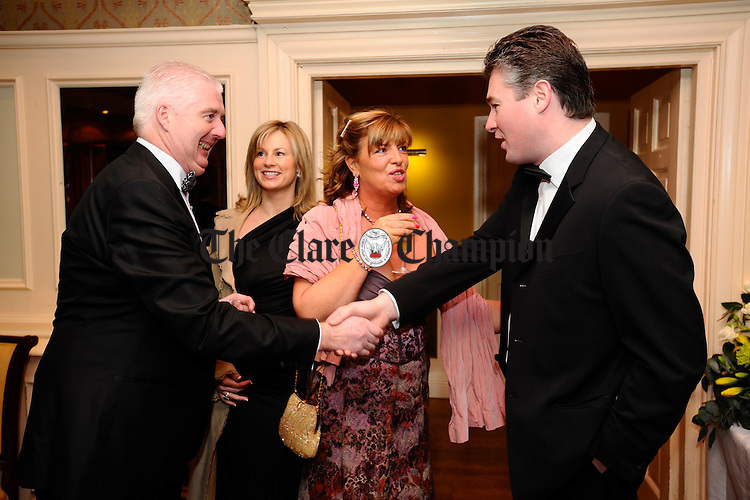 Former president Noel Connellan and Sean Lyne greet at the Ennis Chamber annual Dinner in the Old Ground hotel. Looking on are Maeve Lyne and Janet Connellan. Photograph by John Kelly.
