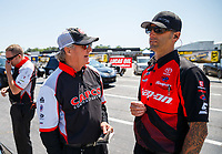 May 6, 2017; Commerce, GA, USA; Richard Hogan (left) crew chief for NHRA top fuel driver Steve Torrence (not pictured) talks to Aaron Brooks during qualifying for the Southern Nationals at Atlanta Dragway. Mandatory Credit: Mark J. Rebilas-USA TODAY Sports