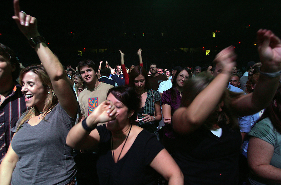 Fans jam to the music of Dave Mathews Band during the concert Friday at the John Paul Jones arena in Charlottesville, Va.