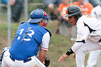 24 july 2010: Boris Marche of Team France tags out at home plate Dwayne Kemp of Netherlands during Netherlands 10-0 victory over France, in day 2 of the 2010 European Championship Seniors, in Neuenburg, Germany.