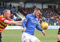 Josh Todd shielding the ball from Steven Anderson in the SPFL Ladbrokes Championship football match between Queen of the South and Partick Thistle at Palmerston Park, Dumfries on  4.5.19.