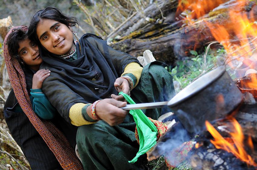 Apa and Salma make tea in the mountains.