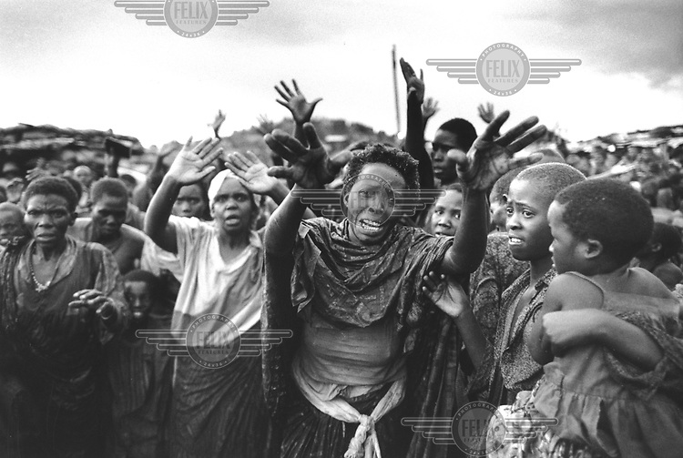©Paul Lowe/Panos Pictures..RWANDA Kibeho    22/4/1995..Hutu refugees in Kibeho camp plead with UN soldiers for protection.  .Over 4000 Hutus were killed earlier in the day during an operation by the Tutsi Rwandan army to clear the  camp.  The tragedy occurred after the army opened fire on the crowd of 100,000 refugees who had been crammed into a small area in the middle of the camp.  The crowd panicked and tried to run, crushing thousands in the melee.  Many more were shot and macheted by the RPA.  The tragedy left over 1000 children orphaned.