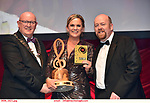 16-6-2019: Róisìn Lawless- Vi Moore- Footloose-Twin Productions, Galway winner of the Best Actress in a Supporting Role at the annual AIMS (Association of Irish Musical Societies) in the INEC Killarney at the weekend receiving the trophy from Seamus Power, President, AIMS left and Rob Donnelly, Vice-President.<br /> Photo: Don MacMonagle - macmonagle.com<br /> <br /> repro free photo from AIMS<br /> <br /> AIMS PRESS RELEASE: There was plenty of glitz and glamour in Killarney on Saturday night as The Association of Irish Musical Societies has its Annual Awards Ceremony in Killarney. Over 1,500 people could be heard over the Kerry mountains as the winners were announced by MC Fergal D'Arcy. Many societies were double winners on the night including UCD Musical Society, Dublin were dancing all the way to the trophies winning Best Choreography and Best Choreographer for Leah Meagher for Cabaret and  Tullamore Musical Society who took their moment as Chris Corroon won Best Male Singer for his sinful performance as Henry Jekyll in Jekyll &Hyde and also Director Paul Norton who'd plenty to celebrate picking Best Director for  the same show. The moment was once again taken by Jekyll&Hyde by Dùn Laoighaire Musical&Dramatic Society as Kevin Hartnett took up Best Male Singer in the Sullivan category.Nenagh Youth Musical Society raised their voices high and took home Best Ensemble. It was a superior night for Enniscorthy Musical Society by winning Best Comedienne for Jennifer Byrne as Mother Superior and Best Technical too. Portlaoise Musical Society rose to the top by taking home Best Overall Show in the Gilbert section for their stunning production of Titanic. Oyster Lane Theatre Group, Wexford flew their flag high taking home Best Overall Show in the Sullivan Section for their breathtaking production of Michael Collins-a Musical Drama.<br /> Other winners on the night included Best Comedian for Ronan Walsh as Officer Lockstock in Urinetown for Trim Musical Society, Best Actress in a Supporting Role for
