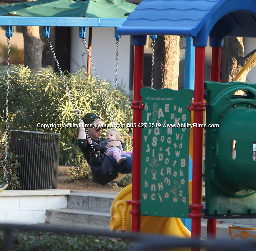 November 27th 2012 <br /> <br /> Alecia Beth Moore Pink at a park swings with her daughter baby Willow Sage Hart<br /> Swinging with her baby on her lap. In Malibu California Cross Creek park <br /> Then Pink went Christmas shopping at CVS market &amp; talked with a paparazzo <br /> <br /> AbilityFilms@yahoo.com<br /> 805 427 3519<br /> www.AbilityFilms.com