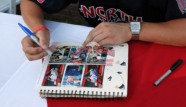 Kyle Skipworth of the Greensboro Grasshoppers signs cards at the 2010 South Atlantic League All-Star Game welcome party and festivities Monday night June 21, 2010, at the Wyche Pavilion along the Reedy River in Greenville, S.C. Photo by: Tom Priddy/Four Seam Images