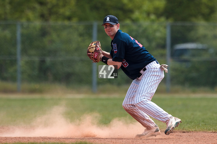 25 April 2010: Aaron Hornostaj of Rouen throws the ball to first base during game 1/week 3 of the French Elite season won 12-4 by Rouen over the PUC, at the Pershing Stadium in Vincennes, near Paris, France.