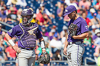 TCU Horned Frogs catcher Evan Skoug (9) and pitcher Jared Janczak (41) talk on the mound during the NCAA College World Series on June 19, 2016 at TD Ameritrade Park in Omaha, Nebraska. TCU defeated Texas Tech 5-3. (Andrew Woolley/Four Seam Images)