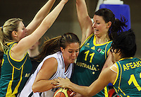 Australia's Carly Wilson, Elyse Penaluna and Eva Afeaki gang up on Kim Barnes during the International women's basketball match between NZ Tall Ferns and Australian Opals at Te Rauparaha Stadium, Porirua, Wellington, New Zealand on Monday 31 August 2009. Photo: Dave Lintott / lintottphoto.co.nz