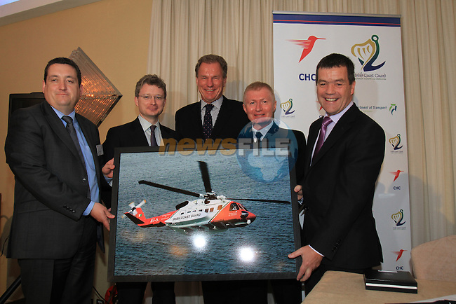 "Minister Dempsey signs New Search and Rescue Helicopter Contract on Behalf of the Irish Coast Guard..Pictured Presenting a Picture of the new Aircraft to the Minister Noel Dempsey, (L) Mark Kelly, Managing Director, CHC Ireland, Mark McComiskey, Chairman CHC, Tilmann Gabriel, President CHC Europe, Chris Reynolds, Director Irish Coast Guard and Minister Noel Dempsey..Picture Fran Caffrey/www.newsfile.ie..Minister Dempsey signs New Search and Rescue Helicopter Contract..""These Helicopters will improve the capacity, range, speed and capability of Ireland's search and rescue service,"" states Dempsey...New type Sikorsky S92A Helicopter on display at ceremony...The Minister for Transport Mr Noel Dempsey, T. D. today signed the contract awarding the provision of Helicopter SAR services to CHC Ireland. Transition to the modern helicopters will start in July 2012, and will run for ten years; with an option to extend for a further three years on a year by year basis. It represents a marked improvement in the capacity, range, speed and capability of Ireland's search and rescue service...The contract represents a continuation of the existing level of service with the principal change being the replacement of the Sikorsky S61N aircraft, with the 'new generation' Sikorsky S92A aircraft. These aircraft will operate out of Waterford, Shannon, Sligo and Dublin...Minister Dempsey said: ""I am delighted to sign this contract which will provide for the delivery of a top-class SAR service operating out of Bases in Waterford, Shannon, Sligo and Dublin up to 2022. There are over 130 jobs in this service and we anticipate that over 20 new posts will be created. CHC Ireland has an excellent record in delivering SAR services to our Coast Guard. The contract provides for helicopters that will fly to the scene of the mission faster. They find the vessels or persons in the water more efficiently using better search, surveillance and tracking tools. This will provide better medical facilities onb"