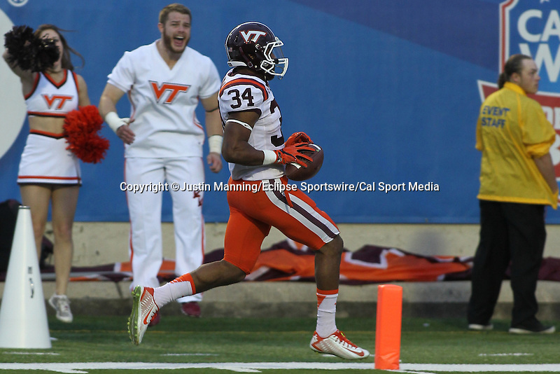 December 26, 2015: Virginia Tech TB Travon McMillian running in for a touchdown during the 1st half of the Camping World Independence Bowl at Independence Stadium in Shreveport, LA. Justin Manning/ESW/CSM