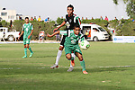 Players of al-Shijaiyah club compete against players of Rafah club during the final match of a local championship, at al-Yarmouk stadium in Gaza city on June 7, 2015. Photo by Mohammed al-Dallow