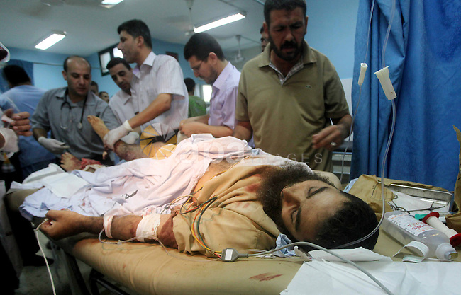 A wounded Palestinian man receives treatment at the al-Aqsa hospital in Deir al-Balah, Gaza strip center, following an Israeli airstrike on September 5, 2012. Photo by Ashraf Amra