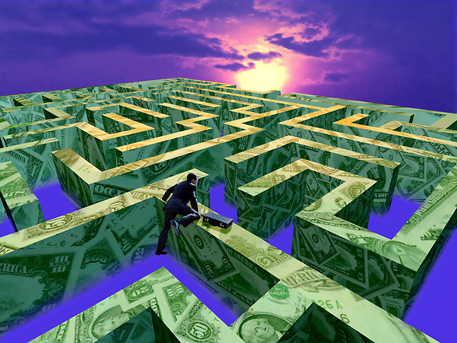 Man climbing over money maze