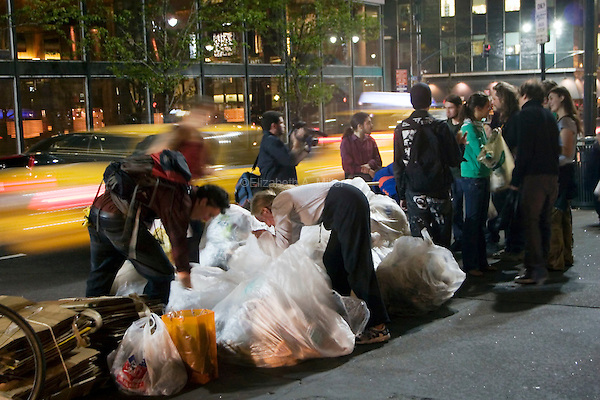 Freegans recover fresh food from the trash outside Au Bon Pain.