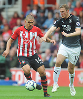 Southampton's Oriol Romeu under pressure from Burnley's Chris Wood<br /> <br /> Photographer Kevin Barnes/CameraSport<br /> <br /> The Premier League - Southampton v Burnley - Sunday August 12th 2018 - St Mary's Stadium - Southampton<br /> <br /> World Copyright &copy; 2018 CameraSport. All rights reserved. 43 Linden Ave. Countesthorpe. Leicester. England. LE8 5PG - Tel: +44 (0) 116 277 4147 - admin@camerasport.com - www.camerasport.com