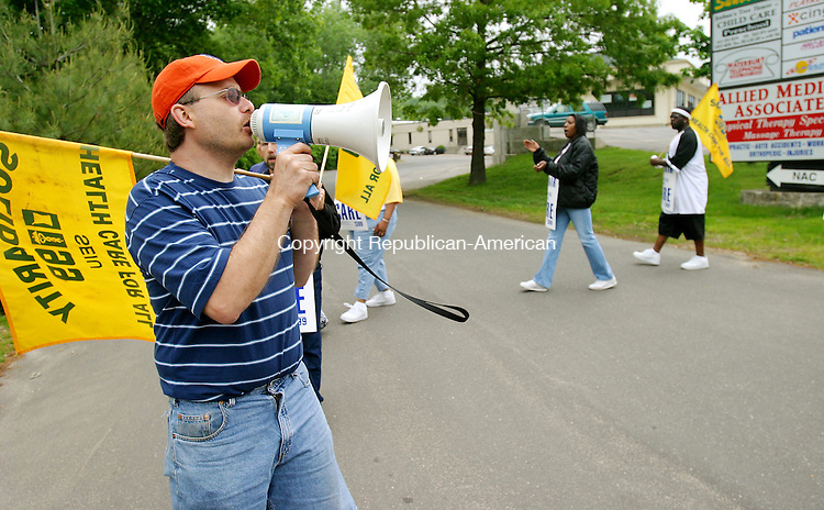 WATERBURY, CT. 01 June  2005--060105SV08--Robert Ruggeri fires up fellow workers with a megaphone during a 1199 strike at the Oak Hill School Day program on 2457 East Main St. in Waterbury Wednesday. Steven Valenti Photo<br /> (Robert Ruggeri,cq))