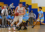 WATERBURY, CT. 14 March 2018-031418BS658 - Zack Penn (25) from Northwestern dribbles around Brandon Gasden (10) from Kolbe Cathedral in the Div IV semi-finals at Kennedy High School on Wednesday evening. Kolbe went on to defeat Northwestern and advanced to the finals at Mohegan Sun. Bill Shettle Republican-American