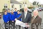 Cormac Bonner Principal of Milltown Secondary school and Eamon Fitzgerald Chairperson of the Board of Management look at the plans on the site where the new school will be built in Milltown with students l-r:  Niamh Ladden, Cathal O'Connor, Siun Riordain, Adrian Murphy and Oonagh Kelliher ...