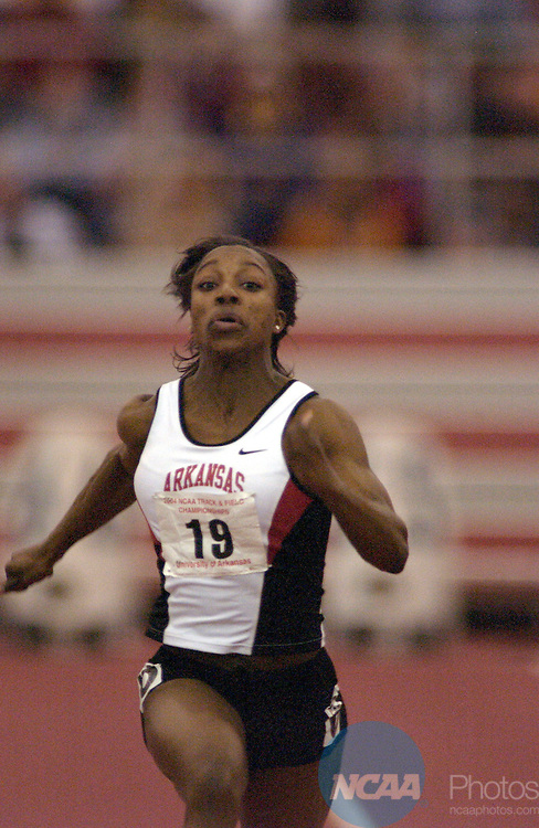 13 MAR 2004:  Veronica Campbell (19) of Arkansas finishes third in the women's 60 meter race with a time of 7.28 seconds during the NCAA Division 1 Women's Indoor Track and Field Championships held at the Randal Tyson Track Center on the University of Arkansas campus in Fayetteville, AR.  Louisiana State University won both the Men's and Women's team titles.Tom Ewart/NCAA Photos