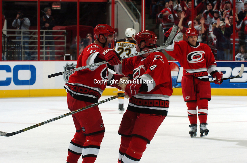 Carolina Hurricanes' Aaron Ward (4) celebrates his game winning goal with teammate Bret Hedican (6) as Doug Weight approaches late in their game with the Boston Bruins at the RBC Center in Raleigh, NC Wednesday, March 1, 2006. The Hurricanes won 4-3...