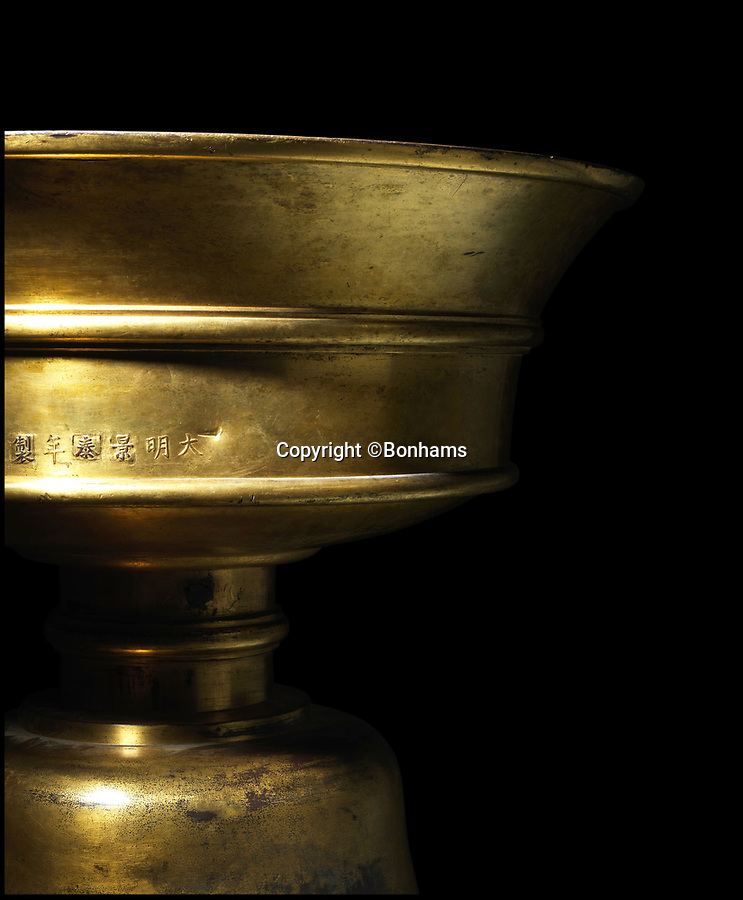 BNPS.co.uk (01202 558833)Pic: Bonhams/BNPS<br /> <br /> Spread the word - Unique Tibetan butter lamp expected to sell for a whopping £2million.<br /> <br /> The enormous bronze lamp, weighing a staggering 53 stone, was made for a Chinese emperor Yingzong 560 years ago.<br /> <br /> The lamp, which stands at 3ft 4ins tall, was one of several commissioned by the Ming Dynasty Emperor, who ruled from 1450 to 1457.<br /> <br /> His reign was fairly controversial and his legitimacy was questioned so he invited Buddhist Tibetan leaders to his court and gave them magnificent gifts to curry favour.<br /> <br /> The lamp was used to light the Tasilhunpo monastry in Shigatse in Tibet using yak butter as fuel.<br /> <br /> The religious relic is now being sold by Bonhams in London on May 17th.