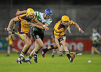 24th October 2013; Chris Crummey, Lucan Sarsfields, in action against Darren Kelly (left) and Peter O'Boyle,  Dublin County Senior Hurling Championship Semi-Final, Craobh Chiarain v Lucan Sarsfields, Parnell Park, Dublin. Picture credit: Tommy Grealy / actionshots.ie