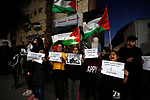 Palestinians hold banners as they participate in a protest against Friday's mass shootings in New Zealand, in the West Bank city of Bethlehem on March 17, 2019. The live-streamed attack by an immigrant-hating white nationalist killed dozens of people as they gathered for weekly prayers in Christchurch on Friday March 15. Photo by Wisam Hashlamoun