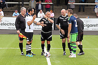 Pictured: The referee tosses the coin, Connor Roberts (R) Saturday 11 July 2015<br />