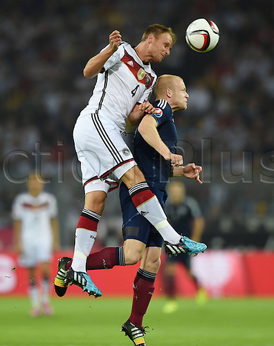 07.09.2014. Dortmund, Germany.   international match Germany Scotland  in Signal Iduna Park in Dortmund. Benedict Hoewedes Germany wins the ehader against Steven Naismith Scotland