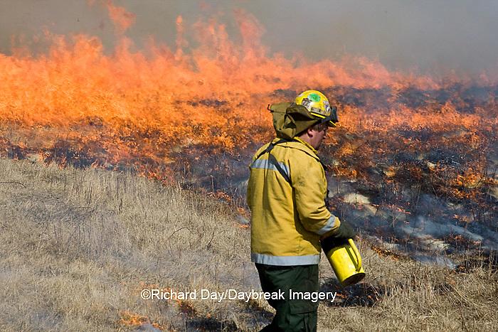 63863-02413 IL DNR biologist at controlled prairie burn, Prairie Ridge State Natural Area, Marion Co. IL